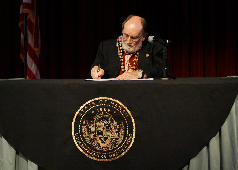 Governor Neil Abercrombie signs a bill allowing same sex marriage to be legal in Hawaii, Nov. 13, 2013.