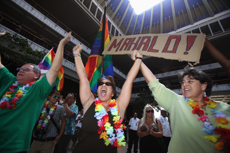 Tambry Young (C) and Debrah Zeleznik (R) celebrate after the Hawaii State Senate approves a bill allowing same-sex marriage to be legal in the state of Hawaii, in Honolulu November 12, 2013.