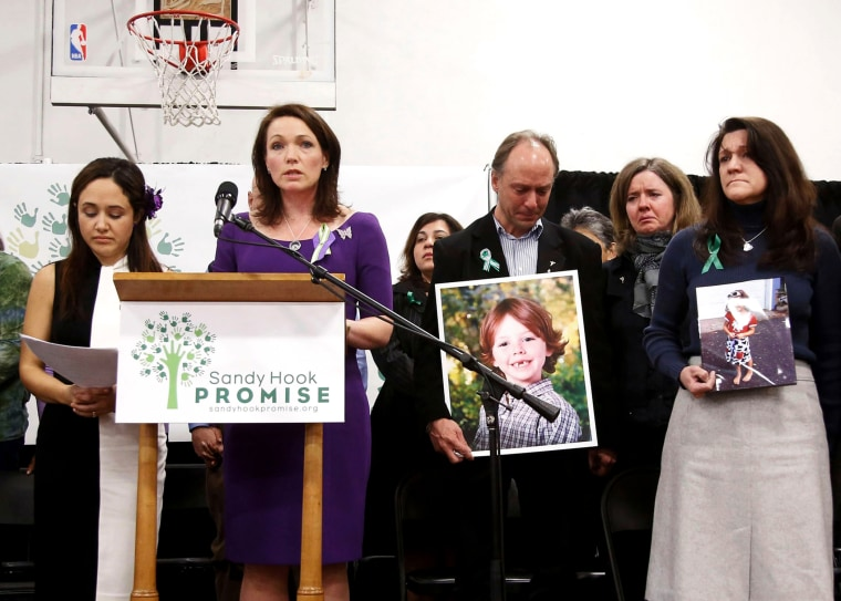 Families of the Sandy Hook shooting victims speak at an event in Newtown, CT.