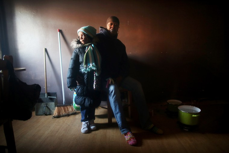 Mac Baker poses with her niece in her unheated apartment in the Ocean Bay public housing projects, Nov. 9, 2012.