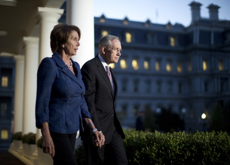 U.S. House Minority Leader Nancy Pelosi (D-CA) (L) and Senate Majority Leader Harry Reid (D-NV) walk from the West Wing of the White House in October 2, 2013, following a meeting with U.S. President Barack Obama.