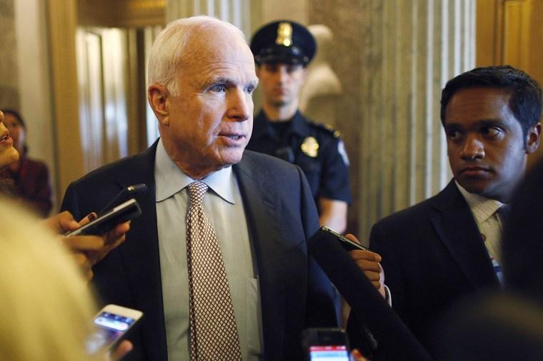 U.S. Senator John McCain talks to reporters as the Senate passes a spending bill to avoid a government shutdown at the U.S. Capitol in Washington on Sept. 27, 2013.