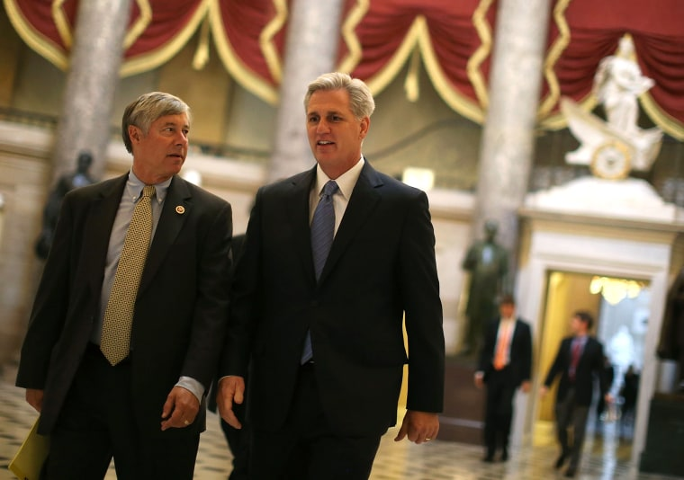 Majority Whip Kevin McCarthy (R-CA) (R) and Rep. Fred Upton R-MI) walk through Statuary Hall at the U.S. Capitol on Oct. 9, 2013 in Washington, DC.