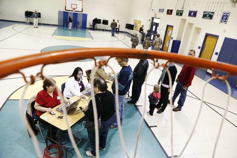 Voters check in to vote at a polling place in Spotsylvania, Virginia, Nov. 5, 2013.