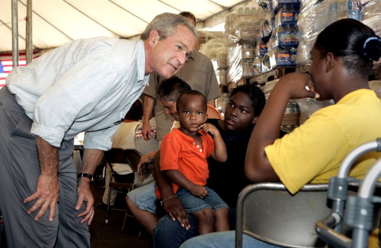President Bush talks people at a food distribution center in Gulfport, Miss.