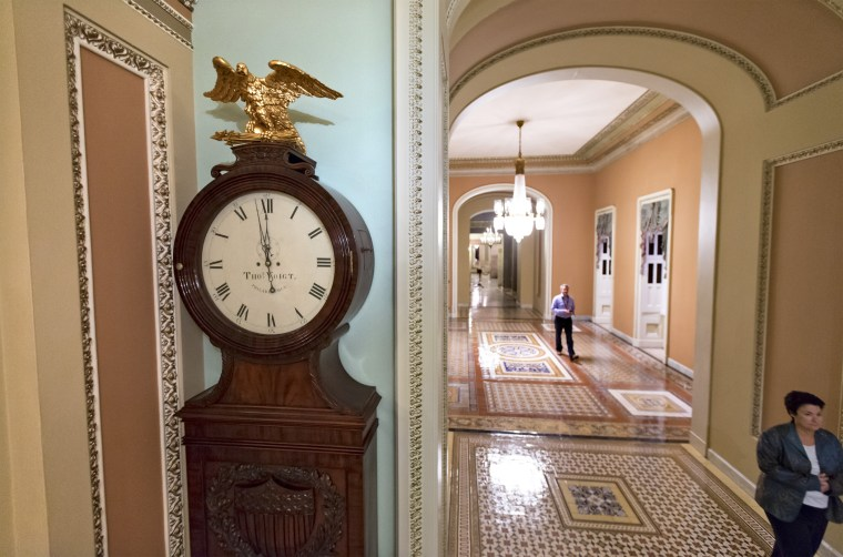 Just off the floor of the Senate, the hands on the famous Ohio Clock inch toward 12 midnight, the deadline for Congress to reach an agreement on funding the government, at the Capitol in Washington, September 30, 2013.