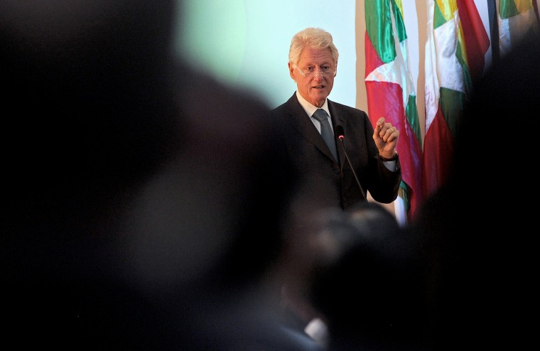 Former US President Bill Clinton talks in Yangon on November 14, 2013.