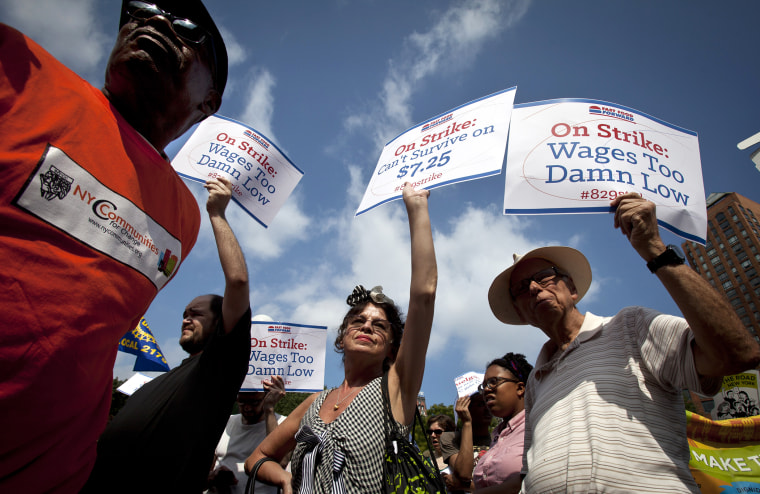 Mira Furman (C) joins with fast food workers to protest the minimum wage in New York on Aug. 29, 2013.