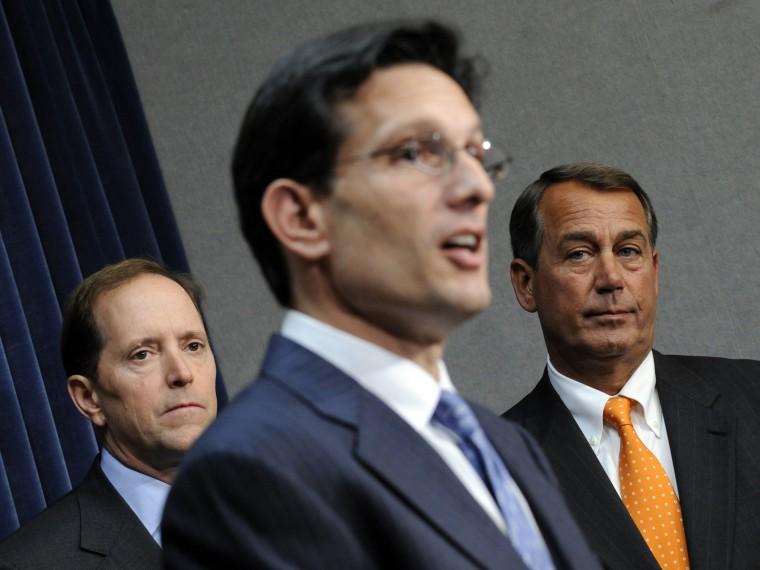 House Speaker John Boehner, right, and Rep. Dave Camp, left,  listen as House Majority Leader Eric Cantor, speaks on Capitol Hill in Washington, D.C., January 21, 2009.