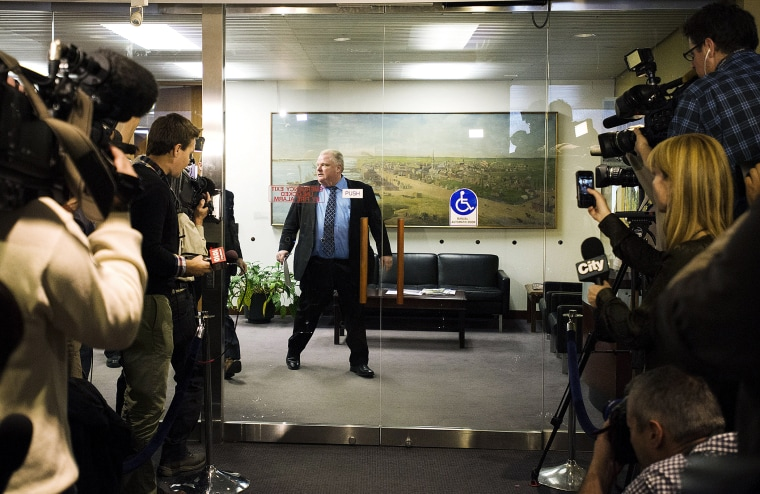 Toronto Mayor Rob Ford walks toward the media on Nov. 15, 2013 in Toronto, Canada.