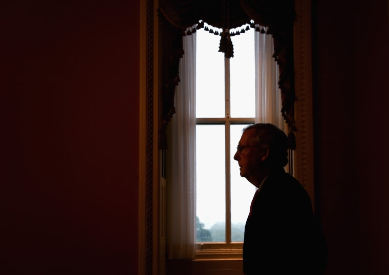 Senate Minority Leader Mitch McConnell (R-KY) returns to his office after speaking in the Senate Chamber, October 7, 2013.