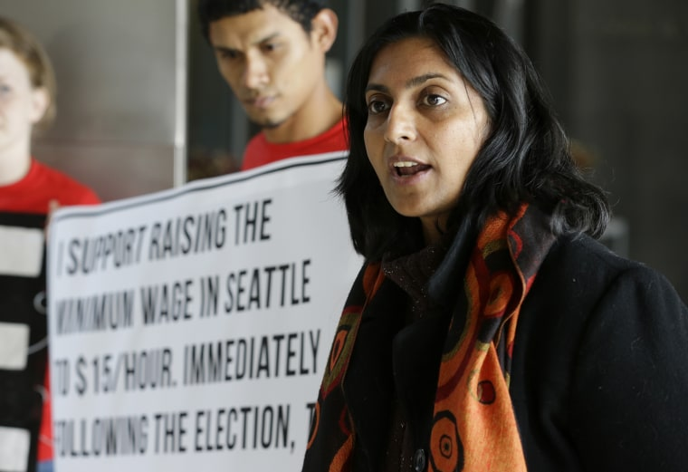 Socialist candidate for Seattle City Council Kshama Sawant speaks outside City Council chambers in Seattle on Nov. 4, 2013.