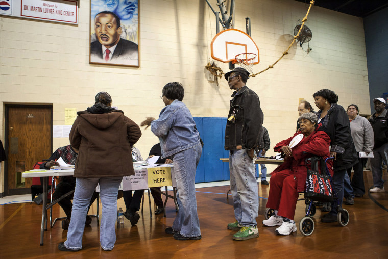 Voters sign in to vote at the Dr. Martin Luther King Community Center for the U.S. presidential election in Racine, Wisconsin on Nov. 6, 2012.