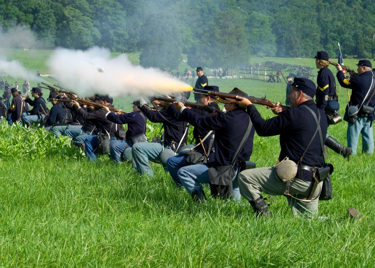 Union soldiers fire a volley at Confederate troops during re-enactment of the Battle of Gettysburg on June 28, 2013.