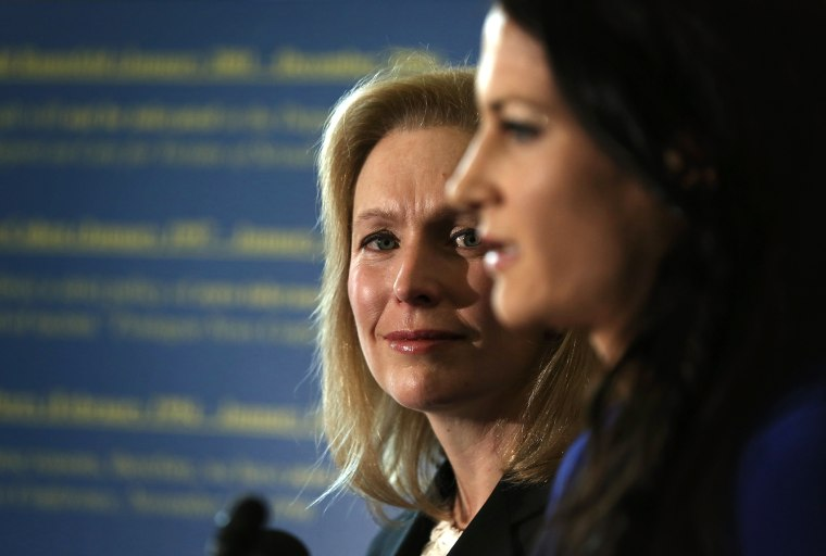 Military sexual assault victim Ariana Klay (R), a former Marine officer assigned to the prestigious Marine Barracks Washington and subsequently served in Iraq, speaks as U.S. Sen. Kirsten Gillibrand (D-NY) (L) listens during a news conference on Nov. 6, 2