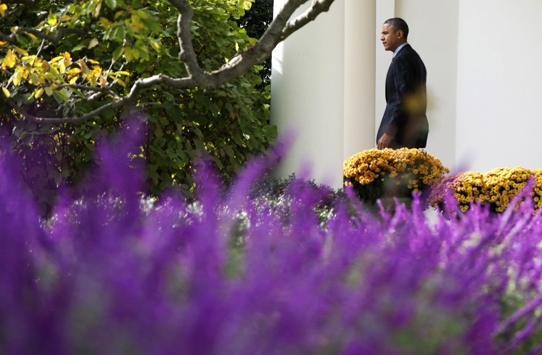President Barack Obama walks out of the Oval Office adjacent to the Rose Garden prior to departing on Marine One from the South Lawn of the White House in Washington, D.C. on Nov. 5, 2013.