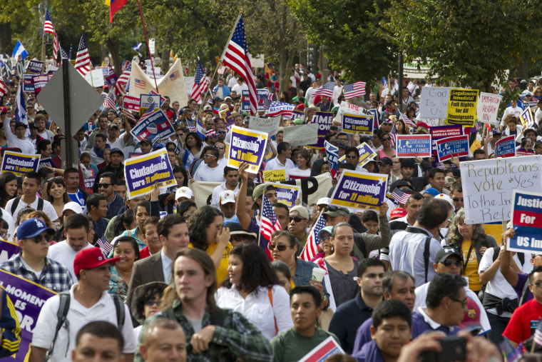 Demonstrators march towards Capitol Hill during a immigration rally and march in Washington, D.C., Tuesday, Oct. 8, 2013.
