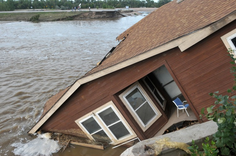 The home of a hired farm hand is shown collapsed near the South Platte River September 17, 2013 near Evans, in eastern Colorado.