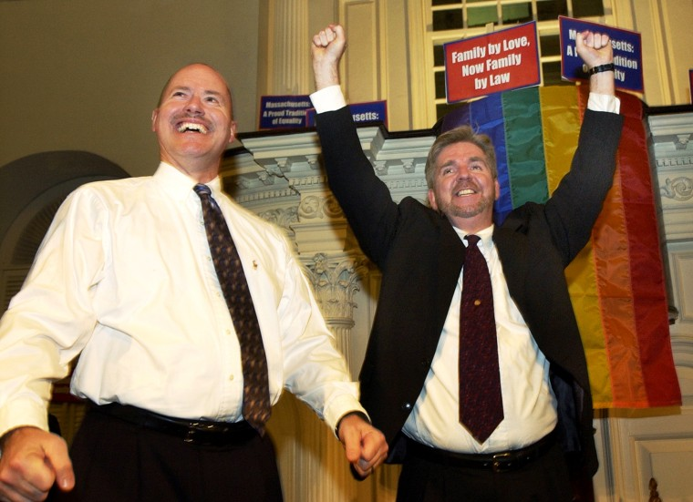 Ed Balmelli, left, and Michael Horgan of Boston, one of seven gay couples who sued the state of Massachusetts, celebrate during a rally at the Old South Meeting House in Boston on Nov. 18, 2003 after the Massachusetts Supreme Judicial Court's ruling that