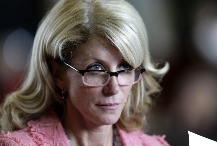 Sen. Wendy Davis, D-Fort Worth, listens as the Texas Senate debate an abortion bill before the final vote on July 12, 2013, in Austin, Texas.