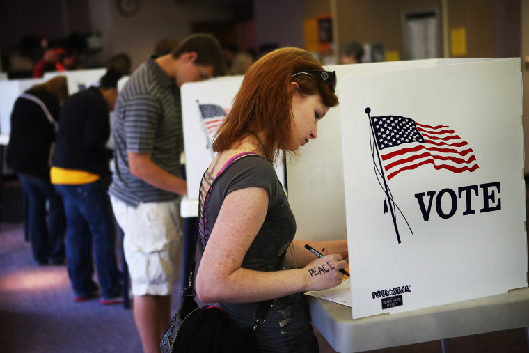 Student Courtney Johnson votes in Cedar Falls, Iowa, September 28, 2012.