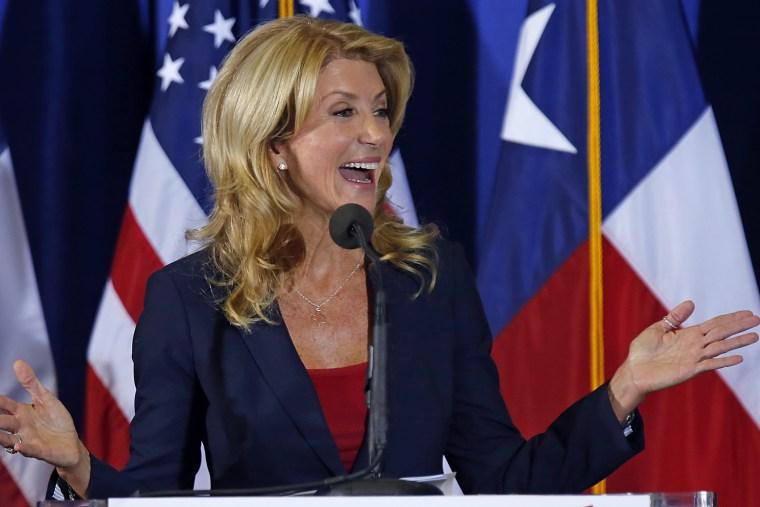Texas State Sen. Wendy Davis speaks at the podium at the W.G. Thomas Coliseum in Haltom City on October 3, 2013 in Haltom City, Texas.