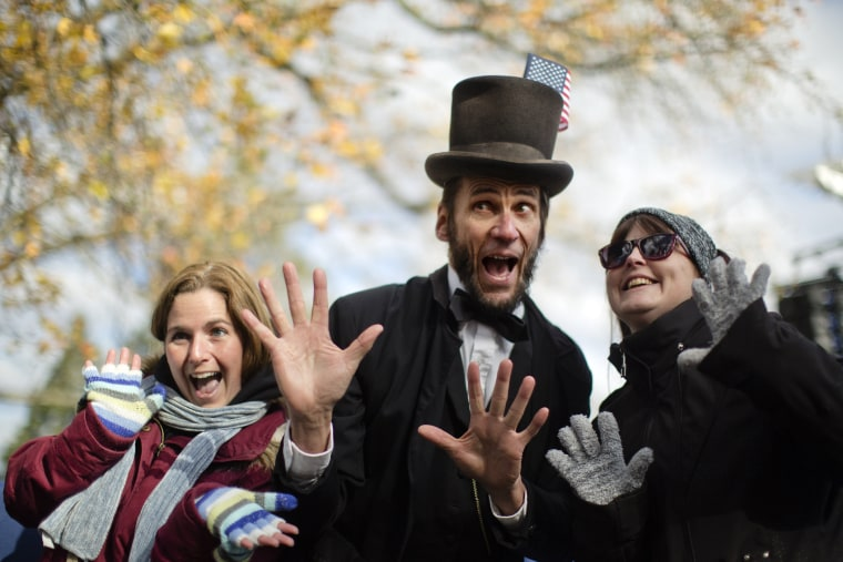 Rick Miller a President Abraham Lincoln re-enactor poses for photographs after a ceremony commemorating the 150th anniversary of the dedication of the Soldiers' National Cemetery and President Abraham Lincoln's Gettysburg Address, Tuesday, Nov. 19, 2013,
