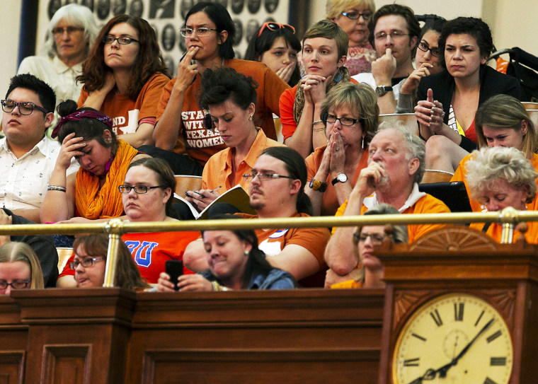 Protesters react during a debate on abortion held at the State Capitol in Austin, TX, June 23, 2013.