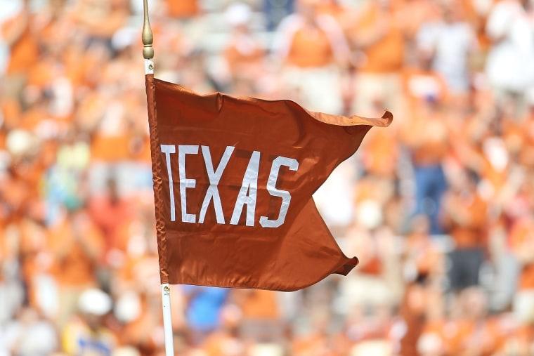 A flag for the Texas Longhorns waves at the Darrell K Royal-Texas Memorial Stadium.