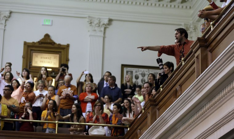 Members of the gallery cheer and chant as the Texas Senate tries to bring an abortion bill to a vote as time expires, Wednesday, June 26, 2013, in Austin, Texas.