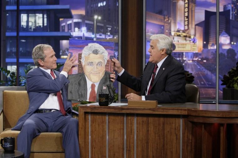 Former President George W. Bush presents Jay Leno with a portrait on Nov. 19, 2013