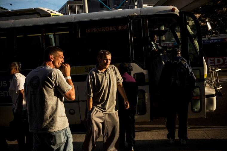 People board a public transit bus in Detroit, Michigan, Sept. 6, 2013.