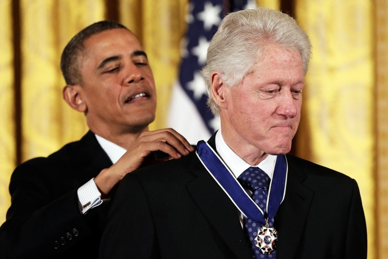 U.S. President Barack Obama awards the Medal of Freedom to former U.S. President Bill Clinton at the White House, Nov. 20, 2013.