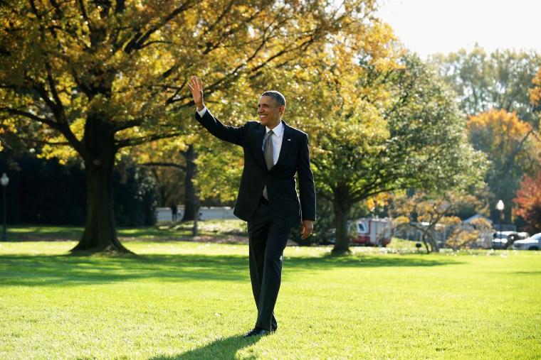 U.S. President Barack Obama waves as he departs the White House, Nov. 8, 2013.