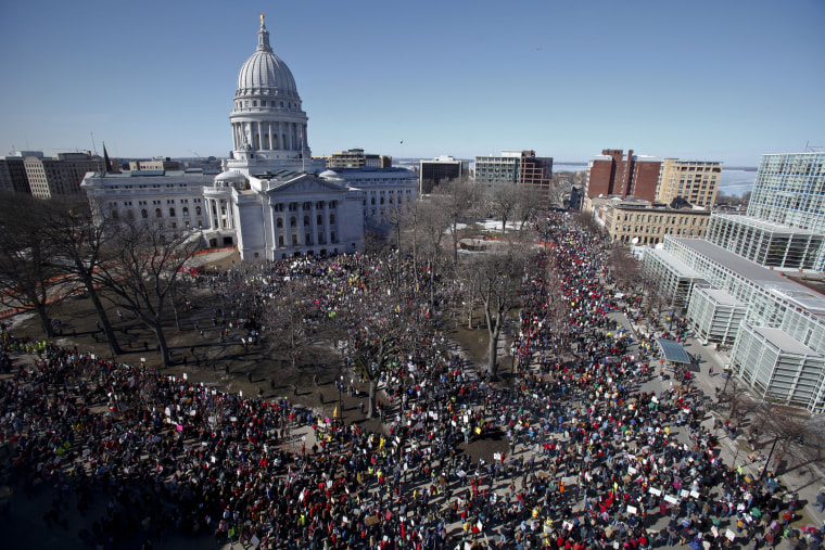 Protesters gather outside the state Capitol in Madison, Wis. on Saturday, Feb. 19, 2011.