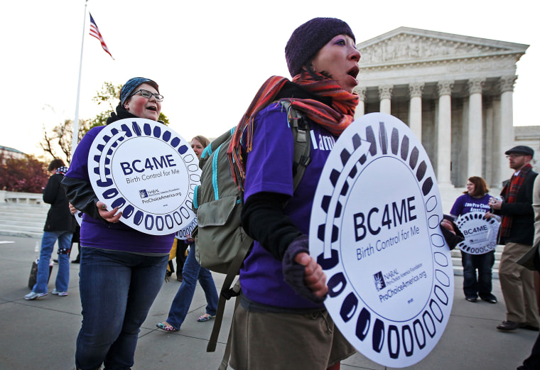 Pro-Obamacare supporters in front of the U.S. Supreme Court, March 27, 2012.