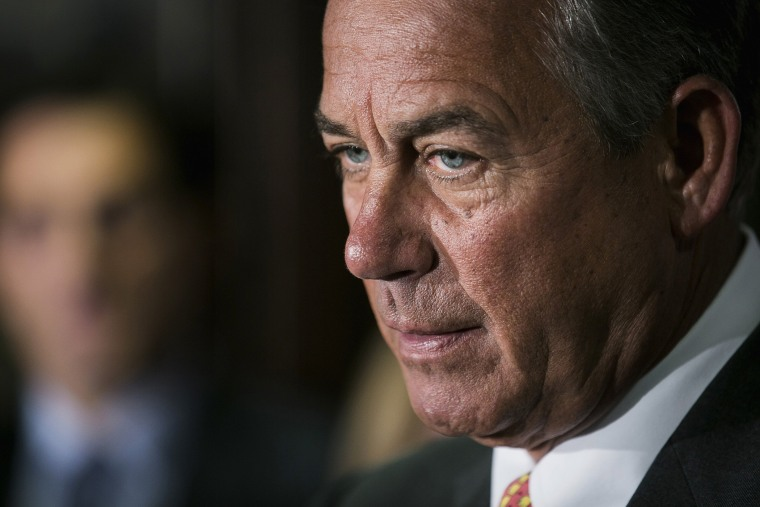 Speaker John Boehner speaks to the press after a Republican conference meeting on November 13, 2013 in Washington, D.C.