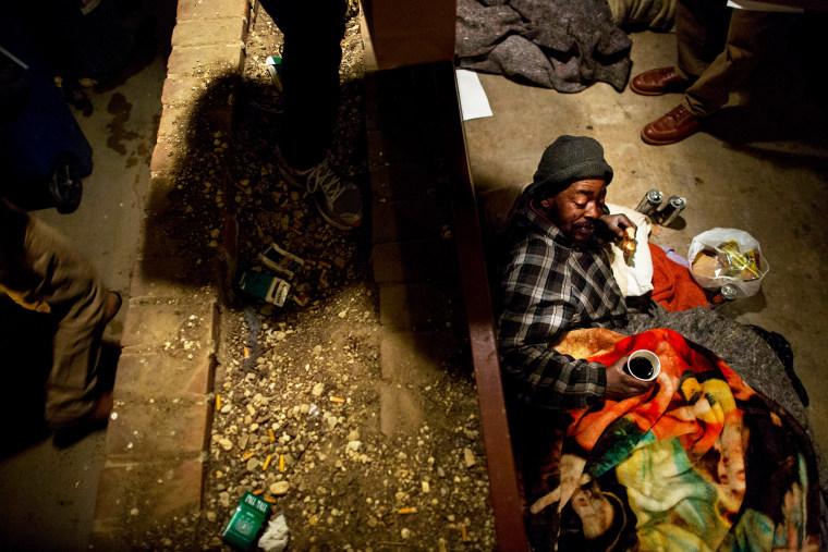 Michael Williams prepares to sleep for the night in Washington D.C., Jan. 31, 2013.