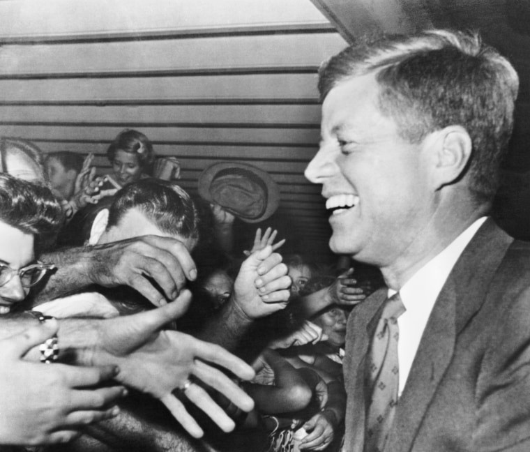 President-elect John F Kennedy smiles as hundreds of well-wishers greet him at the West Palm Beach Airport, Fla. Nov. 11, 1960.
