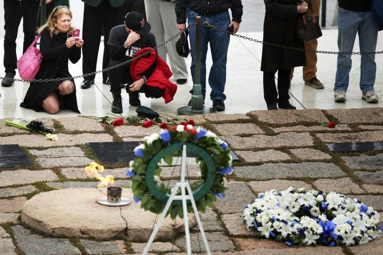 People visit the gravesite of former U.S. President John F. Kennedy at Arlington National Cemetery Nov, 22, 2013.