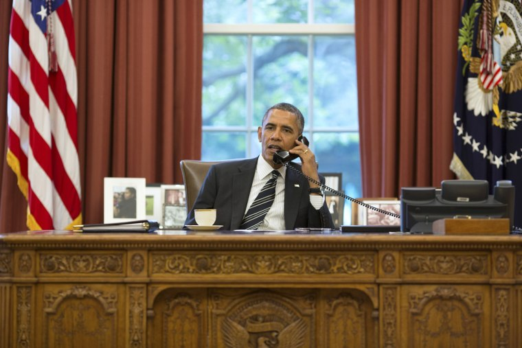 U.S. President Barack Obama during a phone call in the Oval Office at the White House in Washington, September 27, 2013.