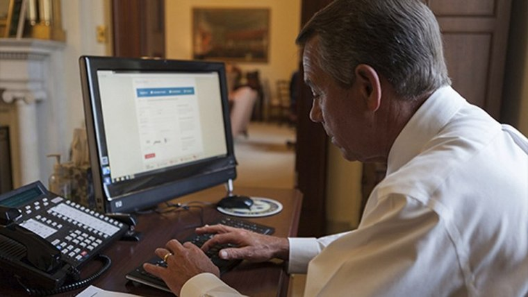 House Speaker John Boehner attempts to sign up for healthcare on the DC Health Link in Washington, November 21, 2013. Boehner said on his blog that he was successfully enrolled after help from the DC Health Link help line.