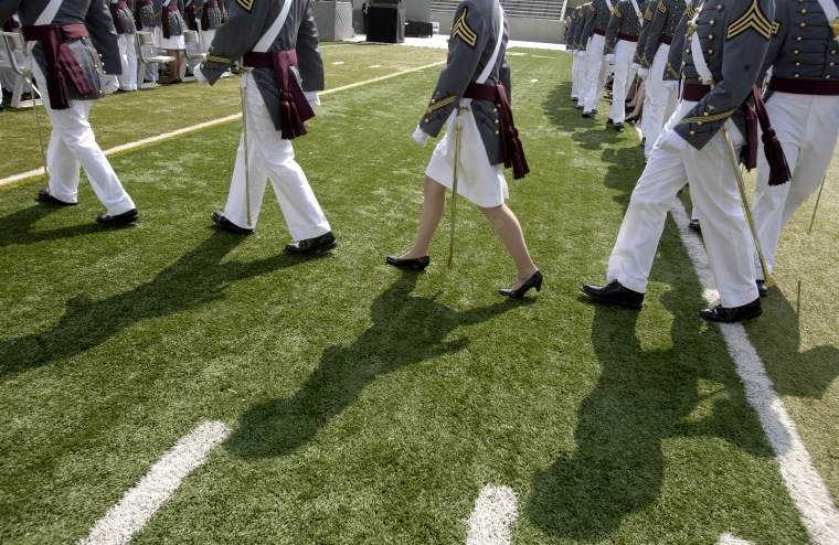 Cadets of The United States Military Academy walk to their seats for a graduation and commissioning ceremony May 26, 2012 in West Point, New York.