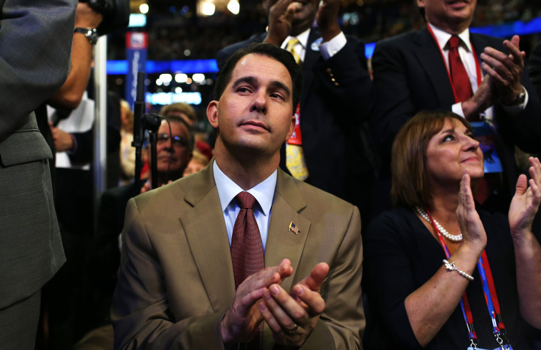 Wisconsin Gov. Scott Walker claps during the third day of the Republican National Convention at the Tampa Bay Times Forum on Aug. 29, 2012 in Tampa, Fla.