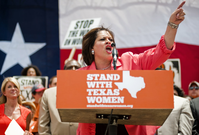 Texas Democratic Senator, Leticia Van de Putte (C) speaks during a women's rights rally before a Special Session of the Texas Legislature in Austin, Texas on July 1, 2013.