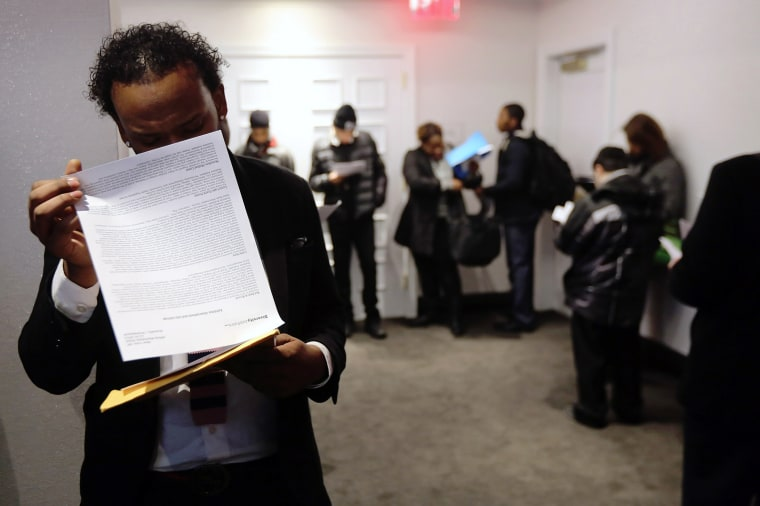 Applicants wait in line to meet potential employers at the Diversity Job Fair on Dec. 6, 2012 in New York, NY.