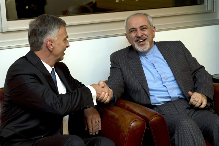 Switzerland's Foreign Minister Didier Burkhalter, left, shakes hands with Iranian Foreign Minister Mohammad-Javad Zarif, during a meeting at the Intercontinental Hotel prior to talks about Iran's nuclear programme in Geneva, Switzerland, Saturday, Nov. 23