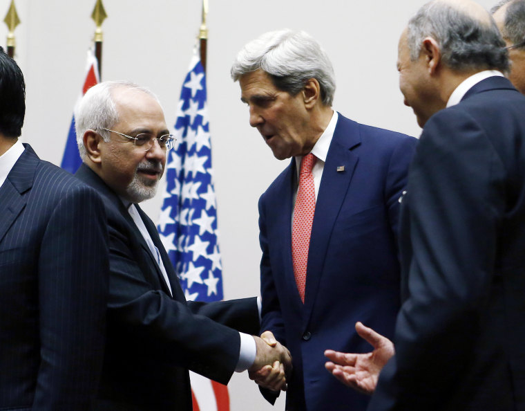 Secretary of State John Kerry (R) shakes hands with Iranian Foreign Minister Mohammad Javad Zarif after a ceremony at the United Nations in Geneva on Nov. 24, 2013.
