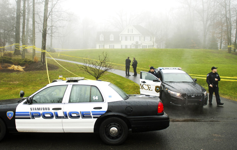 Police outside the home of Nancy Lanza, Dec. 18, 2012.
