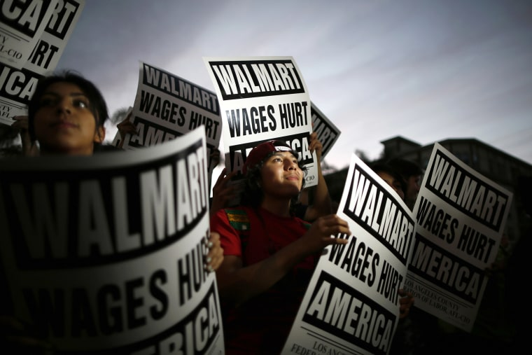 Pedro Taverna, 18, takes part in a protest for better wages outside Wal-mart in Los Angeles on Nov. 7, 2013.